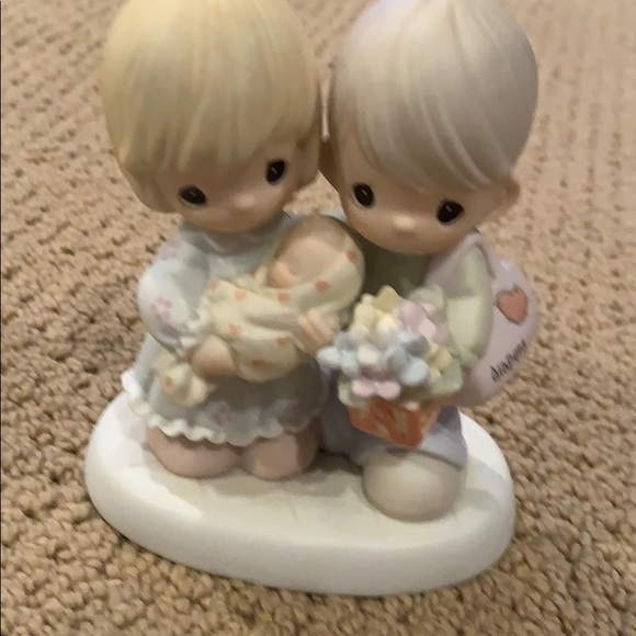 Precious moments blessed with a miracle figurine